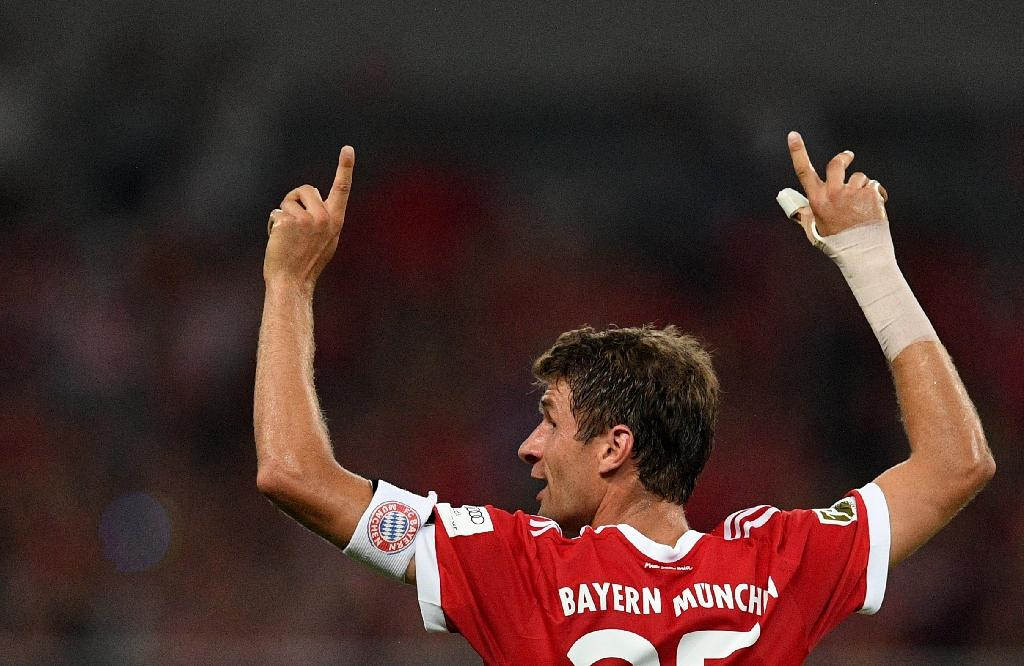 Bayern Munich forward Thomas Mueller scored twice as the German champions beat Premier League winners Chelsea in a Singapore friendly (AFP Photo/Johannes EISELE)