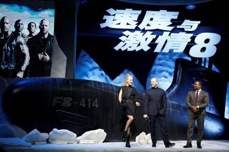 """Actor Charlize Theron and Jason Statham and Director F. Gary Gray attend a media event for the new film """"The Fate of the Furious"""" in Beijing"""
