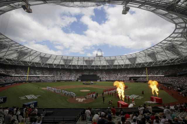 The New York Yankees, left, and the Boston Red Sox line up for the national anthem before a baseball game in London, Sunday, June 30, 2019. (AP Photo/Tim Ireland)