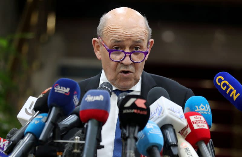 French minister, in Cairo, affirms respect for Islam in dispute over cartoons