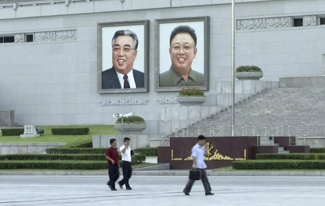 <p>In this image made from video, pedestrians walk beneath portraits of Kim Il Sung, left, and Kim Jong Il at Kim Il Sung square in Pyongyang, North Korea, Friday, Aug. 11, 2017. Despite tensions and talk of war, life on the streets of the North Korean capital Pyongyang remained calm. (AP Photo) </p>