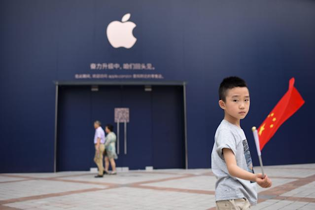 Apple has built major footprints in China from online to physical stores. (Getty/AFP)