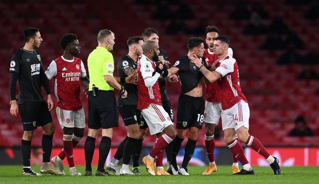 Arsenal midfielder Granit Xhaka, right, grabs Burnley's Ashley Westwood by the throat during a heated moment at Emirates Stadium. Xhaka was initially shown a yellow card for the incident before referee Graham Scott upgraded the punishment to a red after consulting the pitchside monitor. The Gunners slipped to a 1-0 loss against the Clarets, with manager Mikel Arteta claiming the indiscipline showed how committed his players were to addressing their Premier League slump