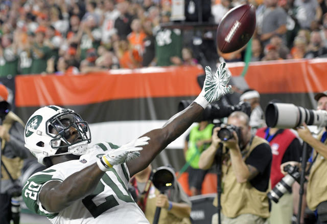 New York Jets running back Isaiah Crowell celebrates after a 7-yard touchdown during the first half of an NFL football game against the Cleveland Browns, Thursday, Sept. 20, 2018, in Cleveland. (AP Photo/David Richard)