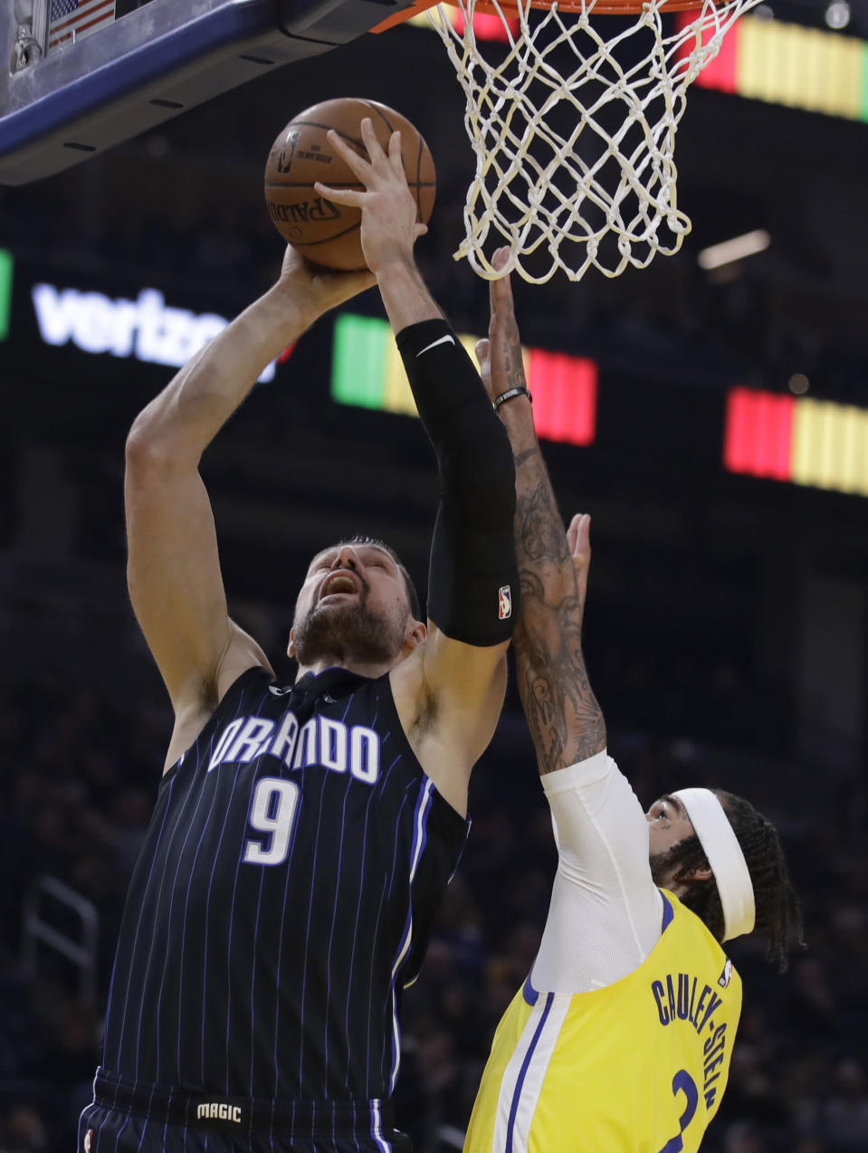 Orlando Magic's Nikola Vucevic (9) shoots against Golden State Warriors' Willie Cauley-Stein during the first half of an NBA basketball game Saturday, Jan. 18, 2020, in San Francisco. (AP Photo/Ben Margot)