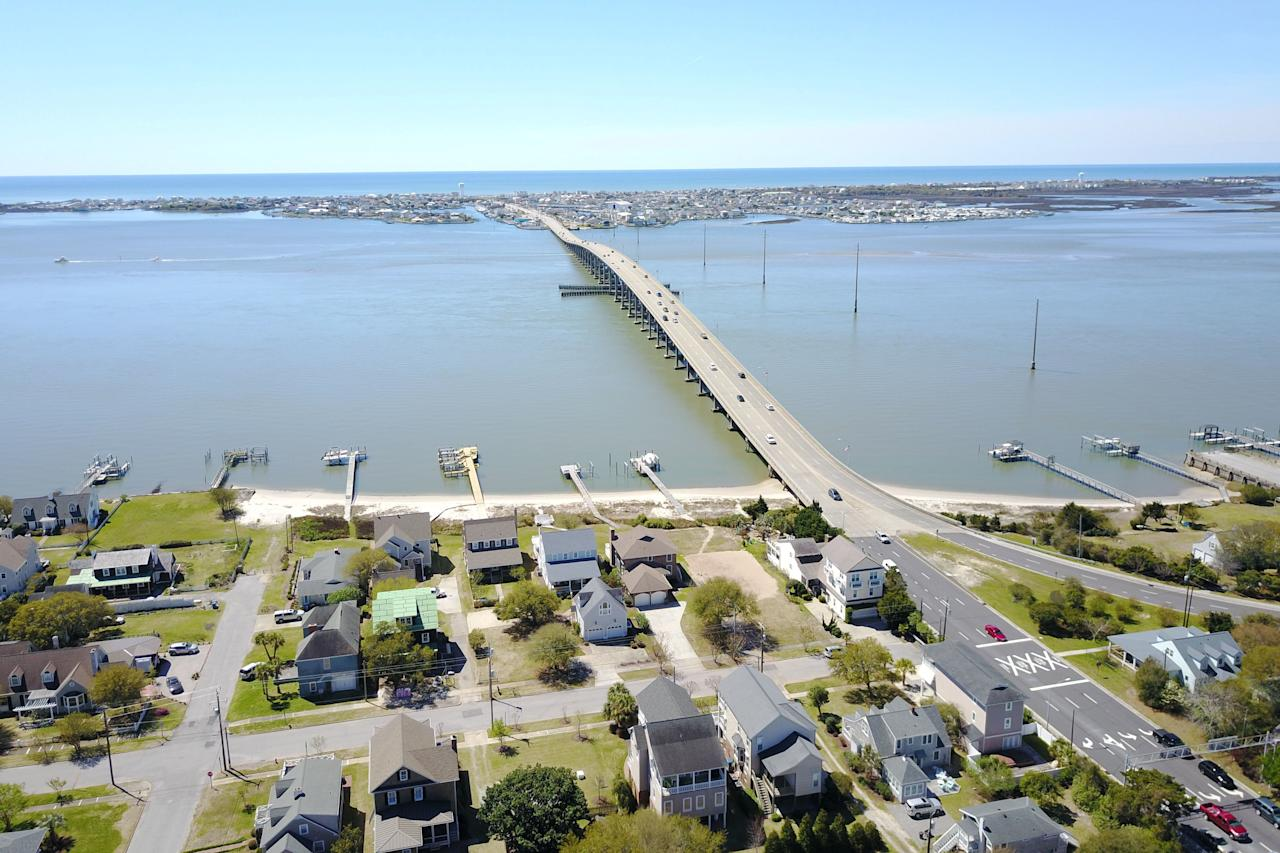 "<p>Median home price: <strong>$327,589</strong></p> <p>Located just west of Cape Lookout National Seashore on the Bogue Sound, Morehead City is a mainland gem with easy access to the Atlantic. Protected by a barrier island, the town boasts pristine beaches and calm waters perfect for launching a paddleboard or simply toddling around in the shallow surf with little ones. If a boat is part of your life-on-the-beach plans, waterfront properties with docks included are easy to find here—and all for a rather reasonable median list price of $327K.</p> <p><b>Related: <a href=""https://www.coastalliving.com/travel/atlantic/best-north-carolina-beach-towns"">The Best Beach Towns in North Carolina</a></b></p>"