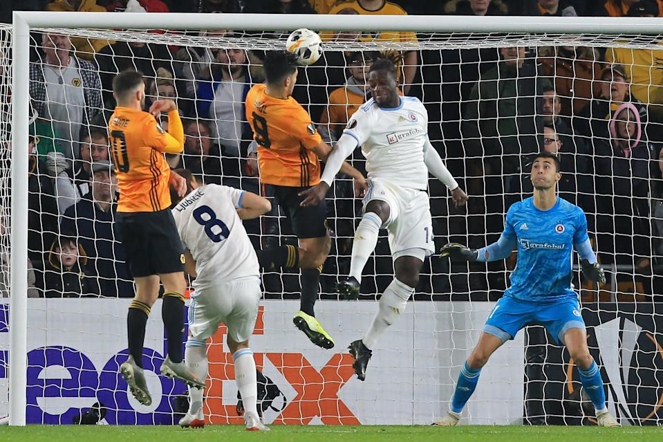 Wolverhampton Wanderers' Mexican striker Raul Jimenez (3rd L) heads home the opening goal of the UEFA Europa League Group K football match between Wolverhampton Wanderers and Slovan Bratislava at the Molineux stadium in Wolverhampton, central England  on November 7, 2019. (Photo by Lindsey Parnaby / AFP) (Photo by LINDSEY PARNABY/AFP via Getty Images)
