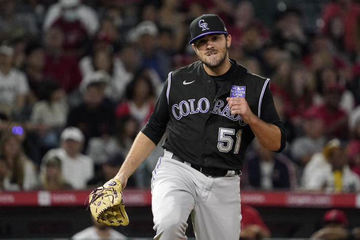 Colorado Rockies relief pitcher Ben Bowden celebrates after striking out Los Angeles Angels' Justin Upton to end the seventh inning of a baseball game Monday, July 26, 2021, in Anaheim, Calif. (AP Photo/Mark J. Terrill)