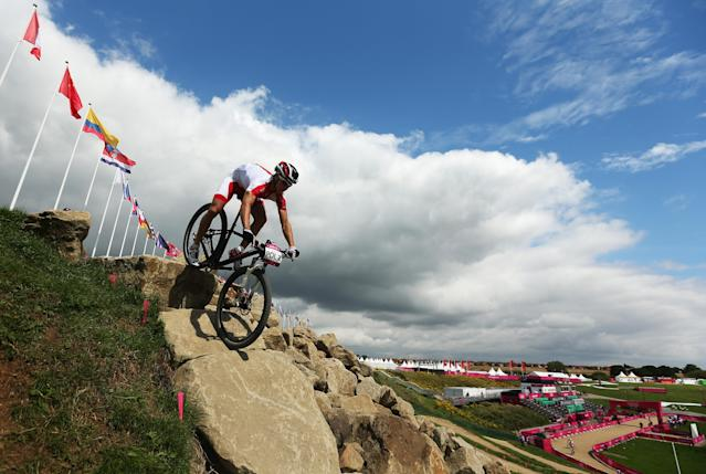 HADLEIGH, UNITED KINGDOM - AUGUST 08: A rider from Poland is seen in action during a Mountain Bike training session on Day 12 of the London 2012 Olympic Games at Hadleigh Farm on August 8, 2012 in Hadleigh, England. (Photo by Bryn Lennon/Getty Images)