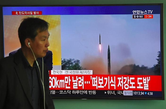 A file television footage of a North Korean missile launch is shown at a railway station in Seoul, on April 5, 2017 (AFP Photo/Jung Yeon-Je)