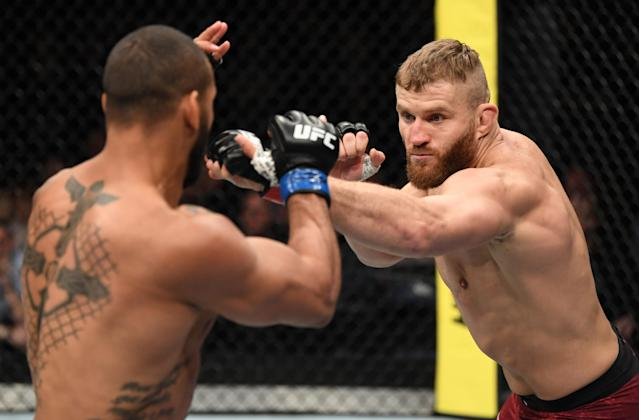 (R-L) Jan Blachowicz punches Thiago Santos in their light heavyweight bout during the UFC Fight Night event at O2 Arena on Feb. 23, 2019 in the Prague, Czech Republic. (Photo by Jeff Bottari/Zuffa LLC/Zuffa LLC via Getty Images)