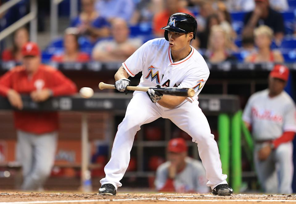 MIAMI, FL - MAY 06: Wei-Yin Chen #54 of the Miami Marlins bunts during the second inning of the game against the Philadelphia Phillies at Marlins Park on May 6, 2016 in Miami, Florida. (Photo by Rob Foldy/Getty Images)