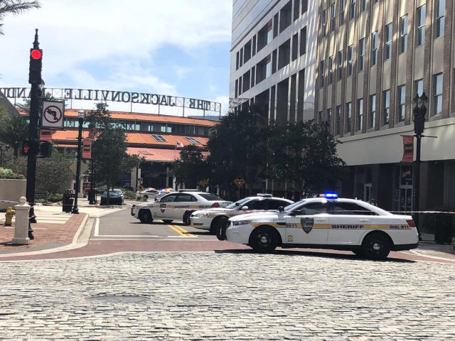 <p>Police at the scene of a shooting in Jacksonville Landing, Jacksonville, Fla., on Aug. 26, 2018. (Photo: Brittney Donovan/Action News Jax) </p>