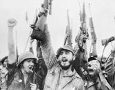 """<p>Fidel Castro, Cuban revolutionary leader, leads his men in a rousing cheer in this scene from """"Rebels of the Sierra Maestra"""" special CBS news report on May 17, 1957, in Havana, Cuba. The exculsive filmed report of life with Castro was recorded by CBS newsman Robert Taber and cameraman Wendell Hoffman. (AP Photo) </p>"""