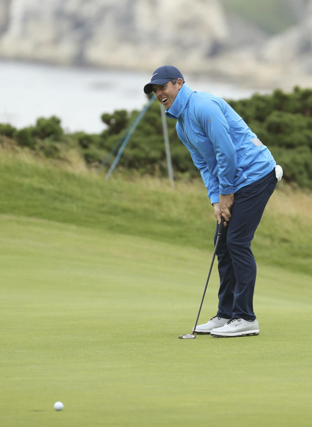 Northern Ireland's Rory McIlroy reacts after putting on the 5th green during a practice round ahead of the start of the British Open golf championships at Royal Portrush in Northern Ireland, Wednesday, July 17, 2019. The British Open starts Thursday. (AP Photo/Peter Morrison)
