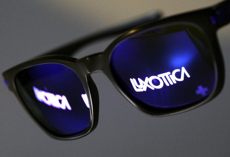 FILE PHOTO: The Luxottica name is reflected in a pair of sunglasses  in this photo illustration taken in Rome