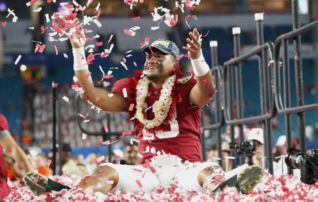 Alabama quarterback Tua Tagovailoa throws confetti in the air after winning the Orange Bowl against Oklahoma in Miami Gardens, Fla. Alabama defeated Oklahoma 45-34. (AP)