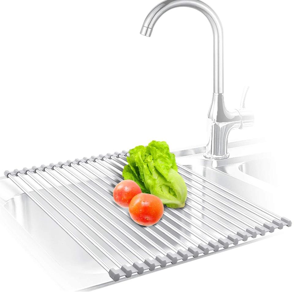 "<br><br><strong>KIBEE</strong> Stainless Steel Roll Up Over The Sink Drainer, $, available at <a href=""https://amzn.to/3cF1R8u"" rel=""nofollow noopener"" target=""_blank"" data-ylk=""slk:Amazon"" class=""link rapid-noclick-resp"">Amazon</a>"