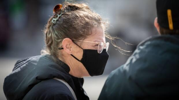 A pedestrian wears a mask outside in Ottawa in March 2021. On Saturday, health officials reported 94 cases of COVID-19 and one new death in the nation's capital.  (Brian Morris/CBC - image credit)