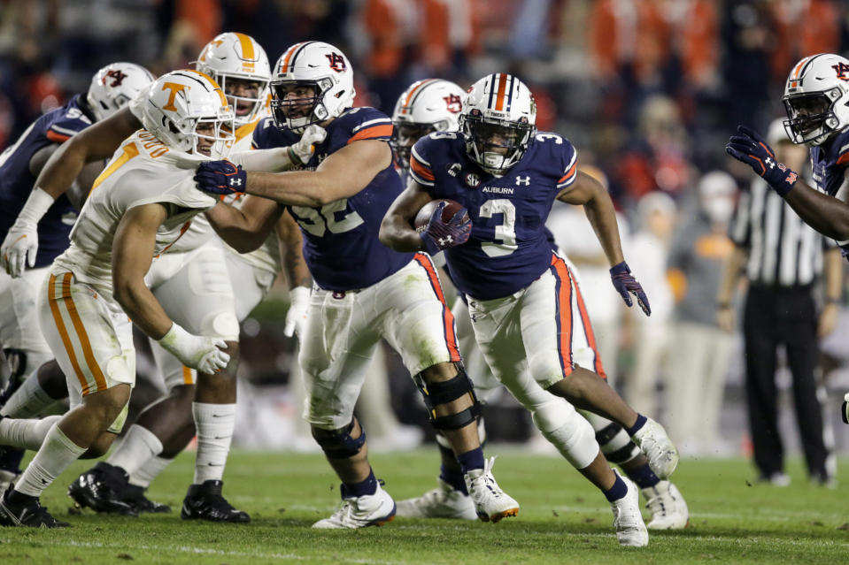 Auburn running back D.J. Williams (3) carries the ball during the first half of the team's NCAA college football game against Tennessee on Saturday, Nov. 21, 2020, in Auburn, Ala. (AP Photo/Butch Dill)