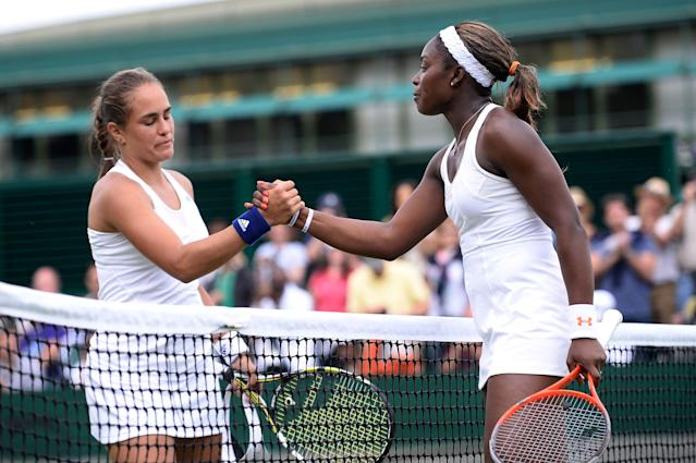 LONDON, ENGLAND - JULY 01: Sloane Stephens of United States of America shakes hands at the net with Monica Puig of Puerto Rico after their Ladies' Singles fourth round match on day seven of the Wimbledon Lawn Tennis Championships at the All England Lawn Tennis and Croquet Club on July 1, 2013 in London, England. (Photo by Dennis Grombkowski/Getty Images)