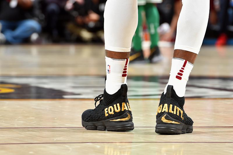 LeBron James wore his political opinions on his shoes during the NBA season opener on Tuesday night.