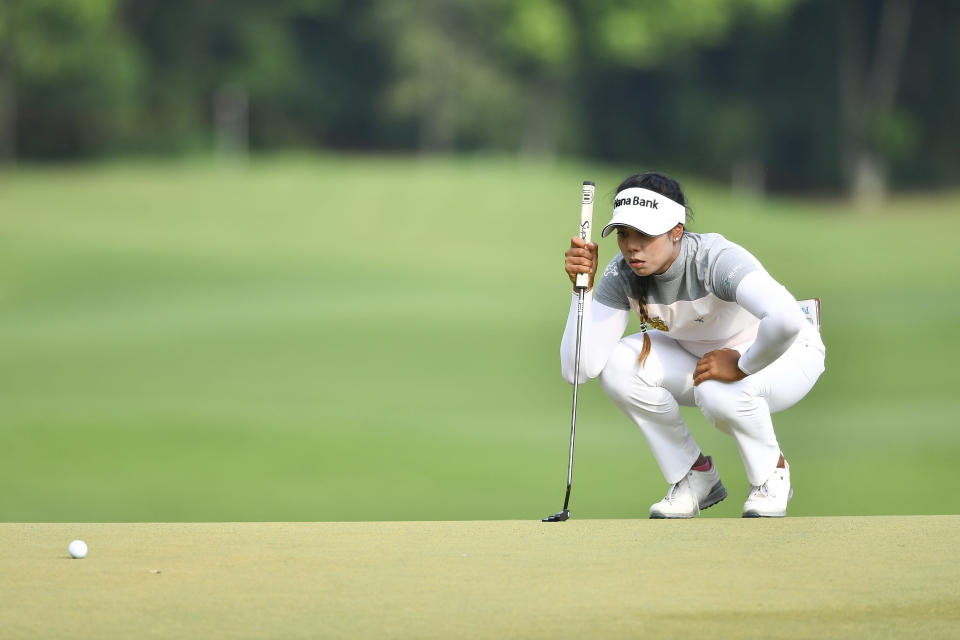 Patty Tavatanakit of Thailand lines up for a putt on the 18th hole during the final round of the LPGA Honda Thailand golf tournament in Pattaya, southern Thailand, Sunday, May 9, 2021. (AP Photo/Kittinun Rodsupan)