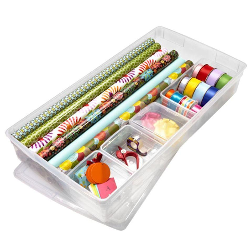 """<p><strong>The Container Store</strong></p><p>containerstore.com</p><p><strong>$34.05</strong></p><p><a href=""""https://go.redirectingat.com?id=74968X1596630&url=https%3A%2F%2Fwww.containerstore.com%2Fs%2Fgift-packaging%2Forganizers%2Fcustomized-gift-wrap-center%2F12d%3FproductId%3D10006022&sref=https%3A%2F%2Fwww.bestproducts.com%2Fhome%2Fcleaning-organizing%2Fg112%2Fwrapping-paper-organizers-storage%2F"""" rel=""""nofollow noopener"""" target=""""_blank"""" data-ylk=""""slk:Shop Now"""" class=""""link rapid-noclick-resp"""">Shop Now</a></p><p>This solid wrapping paper organizer slides under a bed or any other slim space for simple stowing. </p><p>Its four included accessory boxes can each hold ribbons, bows, tags, and tape while leaving plenty of space to stack rolls of wrapping paper on the other side.  </p>"""