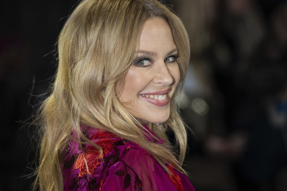 Singer Kylie Minogue poses as engagement revealed