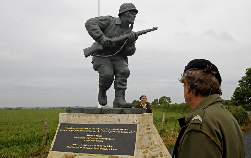 "In this picture taken on Tuesday, June 5, 2012, shows the Colorado-made statue of Pennsylvania native Maj. Dick Winters, unveiled on Wednesday, June 6, 2012 near the beaches where the D-Day invasion of France began in 1944, one of many events marking the 68th anniversary of D-Day, the Allied operation that paved the way for the end of the war. The bronze statue built near the village of Sainte Marie du Mont, is a tribute to a man whose quiet leadership was chronicled in the book and television series ""Band of Brothers."" (AP Photo/Remy de la Mauviniere)"