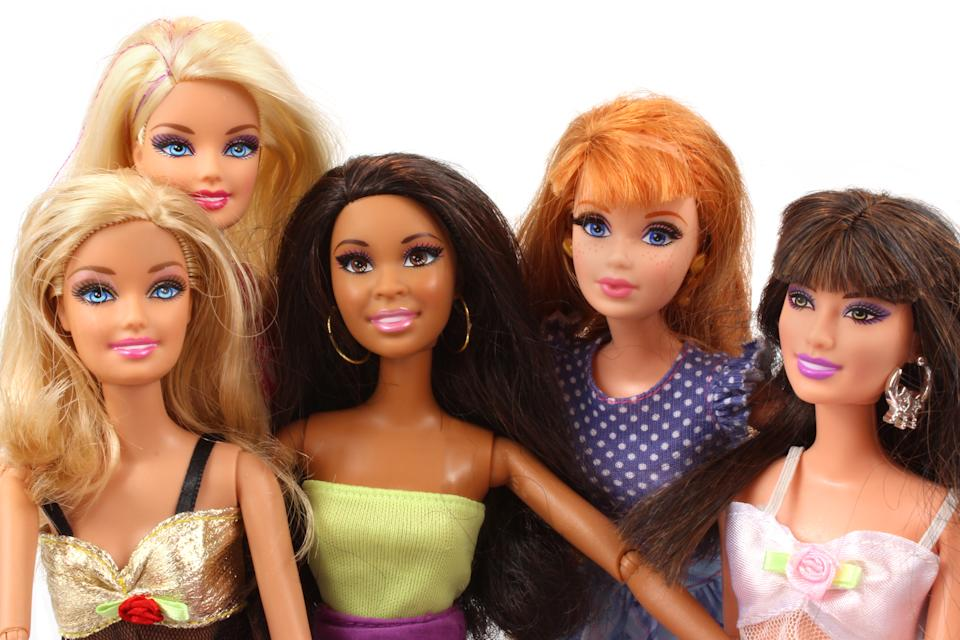Trowbridge, Wiltshire, UK - April 23, 2014: Photograph of  a group of Barbie dolls from Mattel.