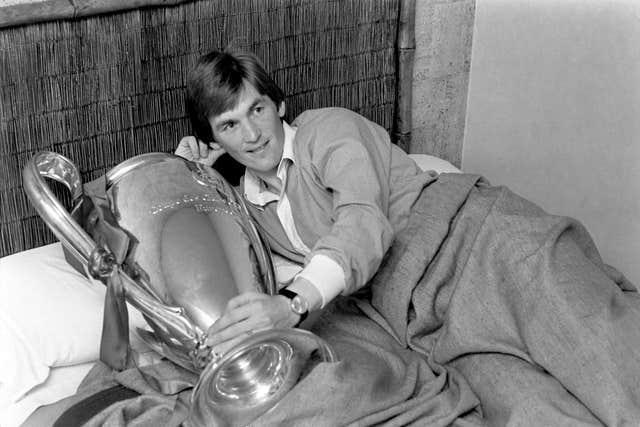 Kenny Dalglish in bed with the European Cup trophy in 1978