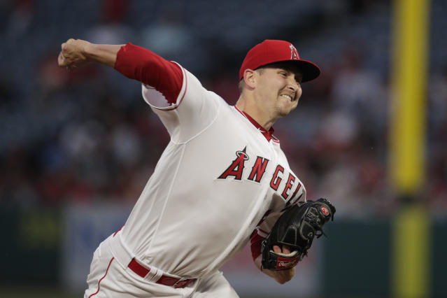 Los Angeles Angels starting pitcher Trevor Cahill throws against the Milwaukee Brewers during the first inning of a baseball game, Monday, April 8, 2019, in Anaheim, Calif. (AP Photo/Jae C. Hong)