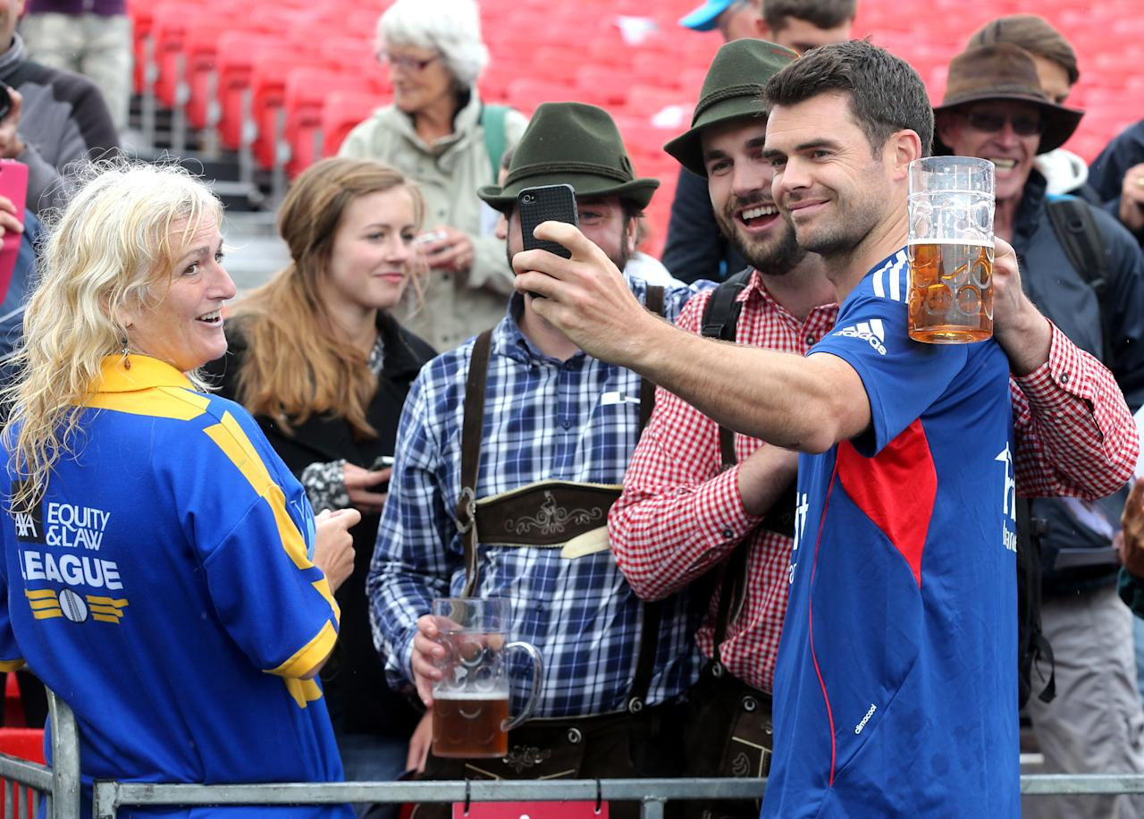 Englands James Anderson with the fans to sign autographs and take pictures who waited after rain stopped play to draw the game and retain the Ashes during day five of the Third Investec Ashes test match at Old Trafford Cricket Ground, Manchester.