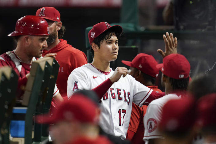 Los Angeles Angels starting pitcher Shohei Ohtani (17) returns to the dugout after pitching during the seventh inning of a baseball game against the Texas Rangers Friday, Sep. 3, 2021, in Anaheim, Calif. (AP Photo/Ashley Landis)