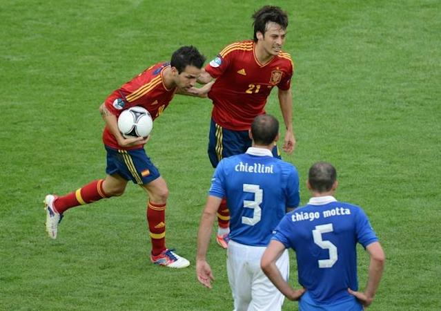 Spanish forward Cesc Fabregas (L) is congratualted by teammate Spanish midfielder David Silva after scoring during the Euro 2012 championships football match Spain vs Italy on June 10, 2012 at the Gdansk Arena. AFPPHOTO/ PATRIK STOLLARZPATRIK STOLLARZ/AFP/GettyImages