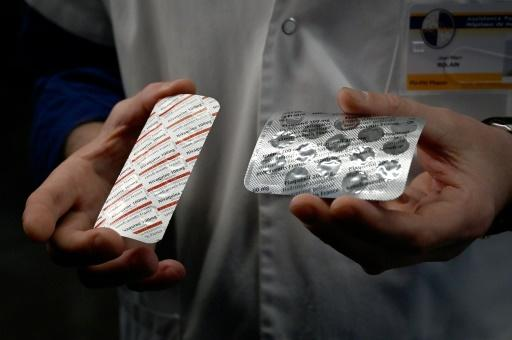 Medical staff at the IHU Mediterranee Infection Institute in Marseille, France show packets of chloroquine and  hydroxychloroquine