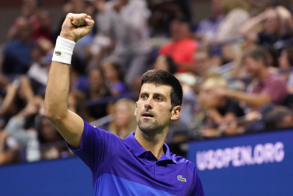 Novak Djokovic, of Serbia, reacts after reaching break point against Jenson Brooksby, of the United States, during the fourth round of the U.S. Open tennis championships, Monday, Sept. 6, 2021, in New York. Djokovic won the match. (AP Photo/John Minchillo)