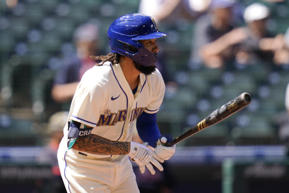 Seattle Mariners' J.P. Crawford watches the path of his two-run single against the Cleveland Indians in the third inning of a baseball game Sunday, May 16, 2021, in Seattle. (AP Photo/Elaine Thompson)