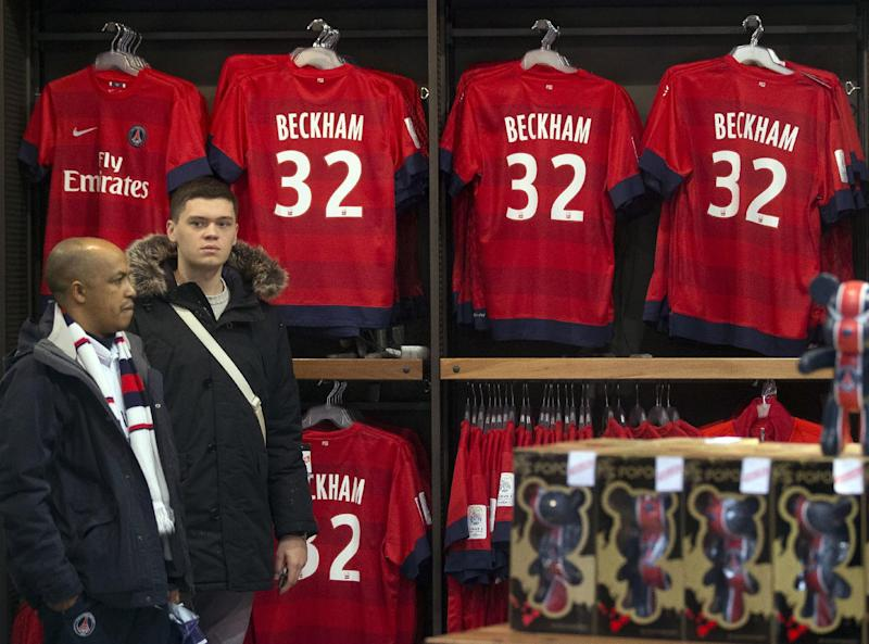 Soccer shirts on display with the name of British soccer player David Beckham, at the the Paris Saint -Germain club's shop on the Champs Elysees, in Paris, Friday, Feb. 1, 2013. The shirts are on sale for euros 110 ($150) each. David Beckham lit up a subdued transfer deadline day in Europe by securing perhaps the final move of his globetrotting career, a surprise short-term deal with ambitious French club Paris Saint-Germain. (AP Photo/Michel Euler)
