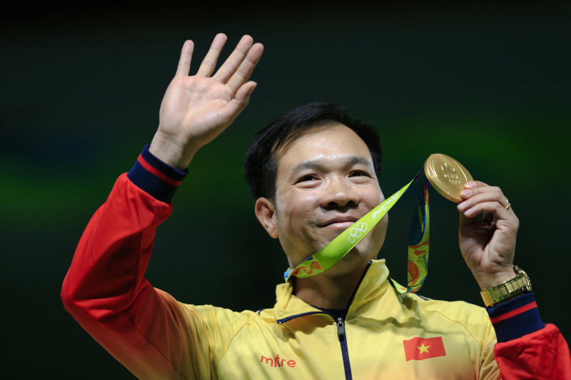Hoang Xuan Vinh of Vietnem displays his gold medal following the victory ceremony for the men's 10-meter air pistol event at Olympic Shooting Center at the 2016 Summer Olympics in Rio de Janeiro, Brazil, Saturday, Aug. 6, 2016. (AP Photo/Hassan Ammar)