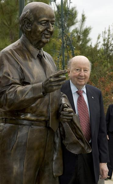 In this Nov. 8, 2007 photo, George P. Mitchell poses with a statue himself at The Woodlands at Town Green Park in The Woodlands, Texas. Mitchell, Texas oil man, real estate developer, and one of Houston's wealthiest businessmen, died Friday, July 26, 2013 at his home in Galveston, a spokeswoman said. He was 94. The oil billionaire created The Woodlands, a master-planned community in the 1970s, north of Houston. (AP Photo/ Houston Chronicle, Brett Coomer)