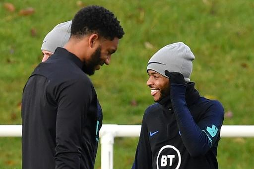 Defender Joe Gomez (left) and forward Raheem Sterling attend an England team training session on November 12, 2019