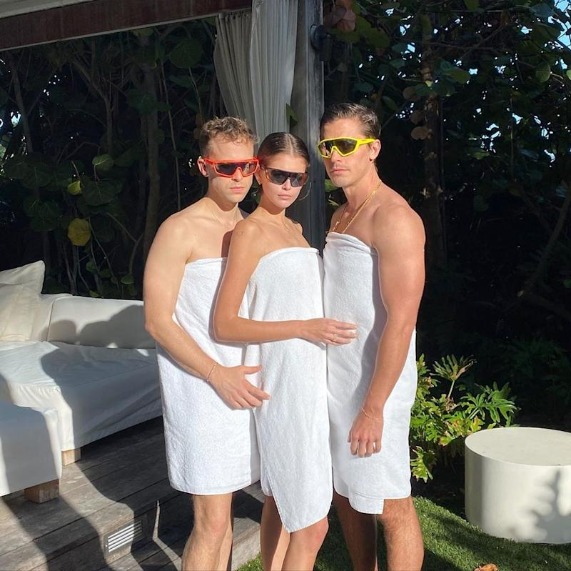 Kaia Gerber, Tommy Dorfman, and Antoni Polowitz pose in towels