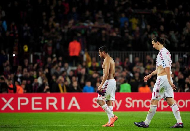 AC Milan's Swedish forward Zlatan Ibrahimovic (R) and AC Milan's Brazilian forward Robinho react at the end of the Champions League quarter-final second leg football match FC Barcelona vs AC Milan on April 3, 2012 at Camp Nou stadium in Barcelona. FC Barcelona defeated AC Milan 3-1 to reach the semi-finals. AFP PHOTO / OLIVIER MORIN