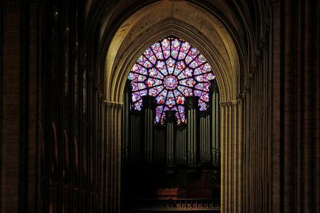 A view shows the organ and a rose window inside the Notre Dame Cathedral in Paris, France, August 28, 2017. Officials at the 854-year old Notre-Dame cathedral, France's most-visited monument, say it is in urgent need of raising 100 million euros ($120.40 million) to repair everything from damaged arches and statutes to broken down gargoyles.  REUTERS/Philippe Wojazer