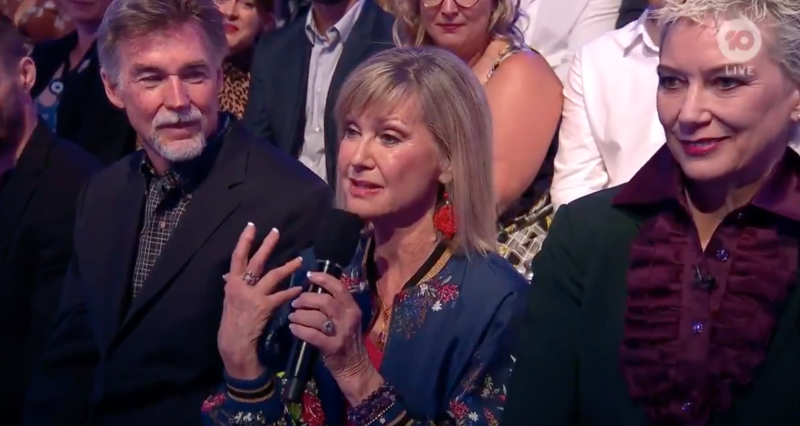 Olivia Newton-John speaks into the microphone on Dancing With The Stars