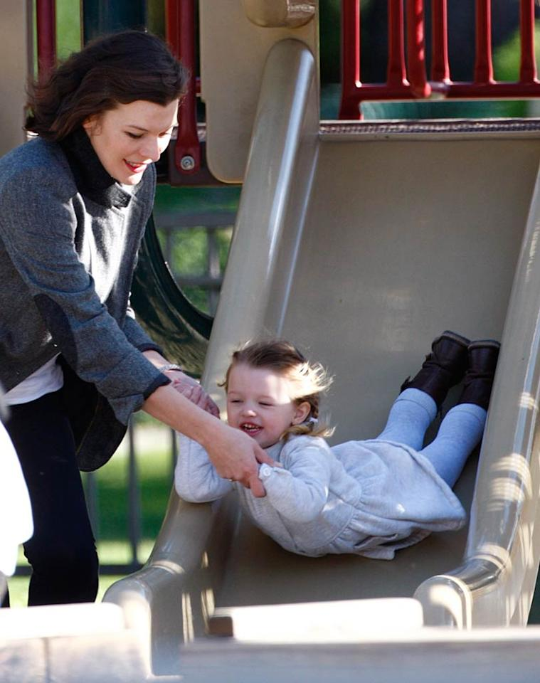 """Wheeeeee! Milla Jovovich's helped her adorable daughter Ever take a ride down a slide at Beverly Hills' Coldwater Canyon Park. Edwin-Kmm-Lins-Mbf/<a href=""""http://www.x17online.com"""" target=""""new"""">X17 Online</a> - February 22, 2010"""