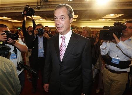The leader of the UK Independence Party, Nigel Farage, arrives to speak at the party's annual conference in central London