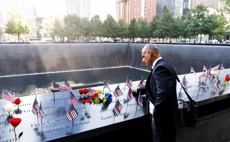 A man touches the engraved names of firefighters at the South Pool of the National September 11 Memorial during ceremonies marking the 18th anniversary of the September 11, 2001 terrorist attacks in New York, New York, USA, 11 September 2019. EFE/EPA/JUSTIN LANE